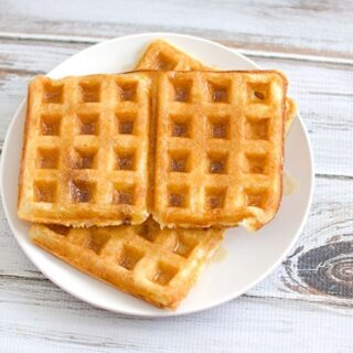 Overnight-Yeasted-Waffles-with-Butter-and-Maple-Syrup