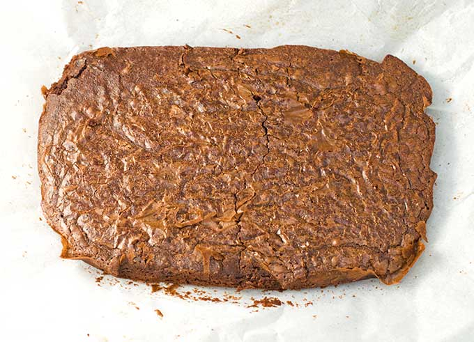 How-to-Make-Boxed-Brownie-Mix-Taste-Homemade-Brownies-on-Parchment.jpg