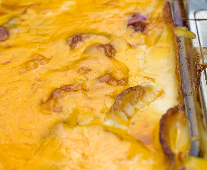 Cheesy Scalloped Potatoes Recipe | This easy scalloped potatoes recipe is full of cheesy goodness. It's great as a side dish for just about any meal, but especially during Thanksgiving and Christmas with ham or a standing rib roast. I'll admit I even like to eat the leftovers for breakfast!