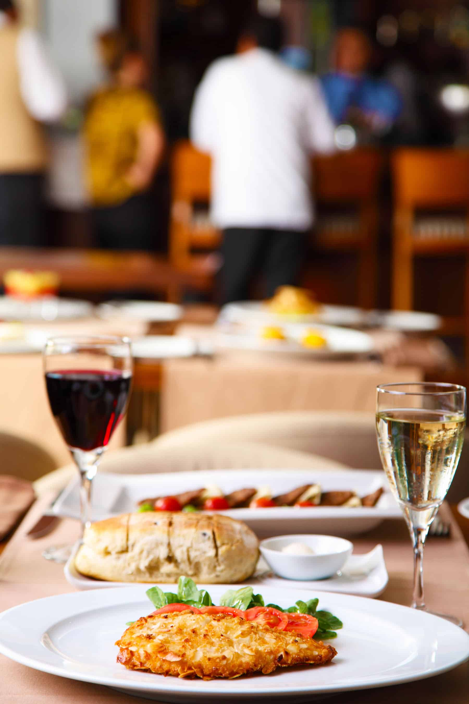 Tips For How to Save Money On Eating Out - Restaurant Photo with food and wine