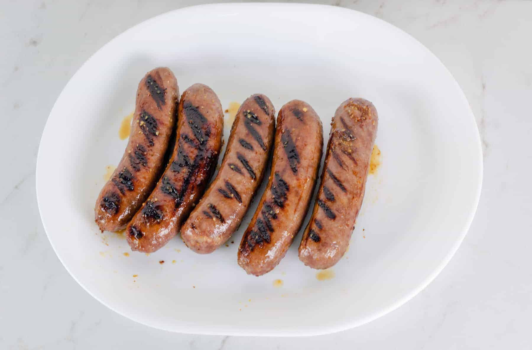 Honey Mustard Beer Glazed Bratwurst Recipe Picture - grilled bratwurst on a platter